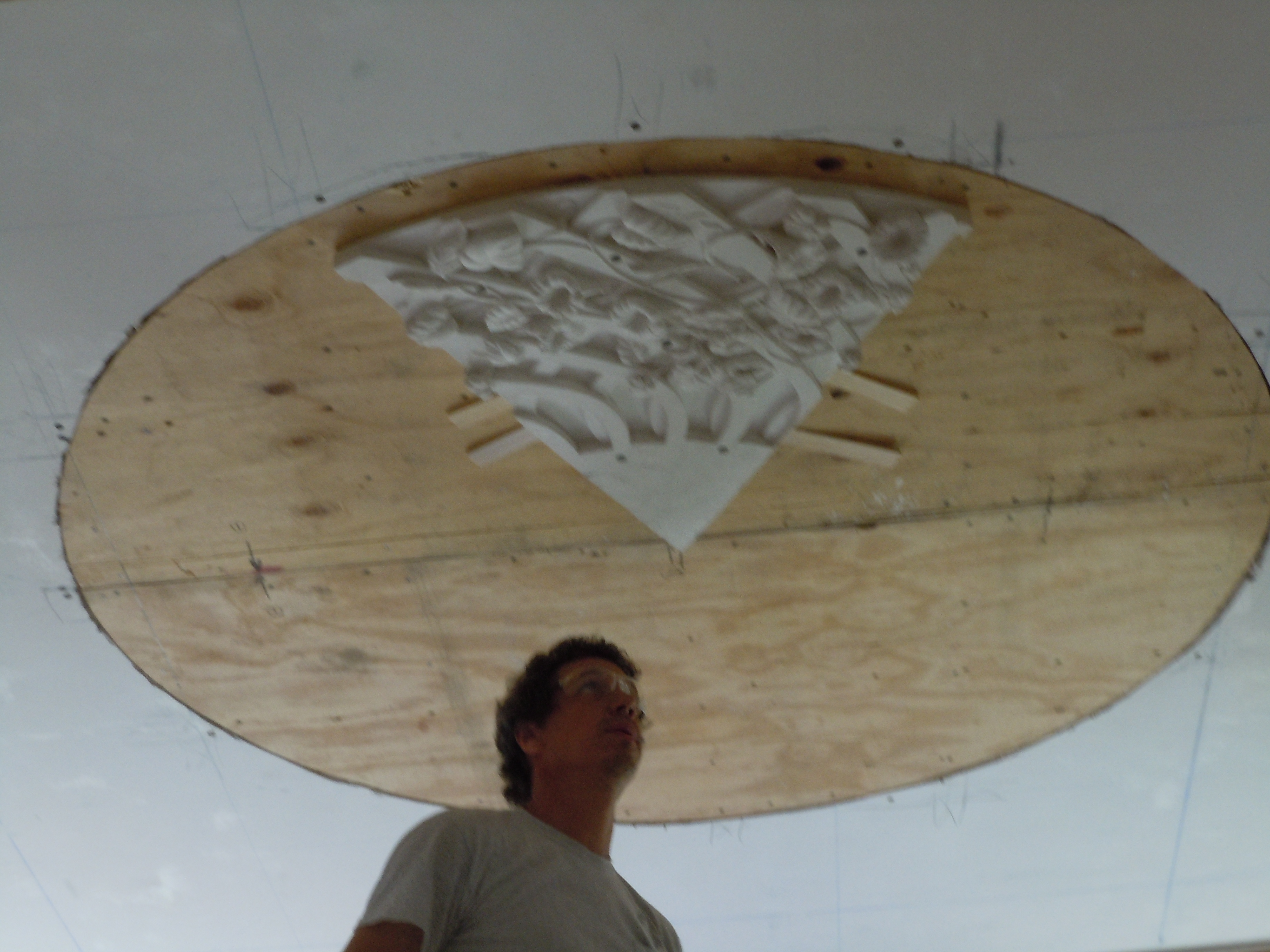 Greg Jacobs of Land mark Preservation working on securing the heavy plaster medallion in Glen Mary's front room- July 2018
