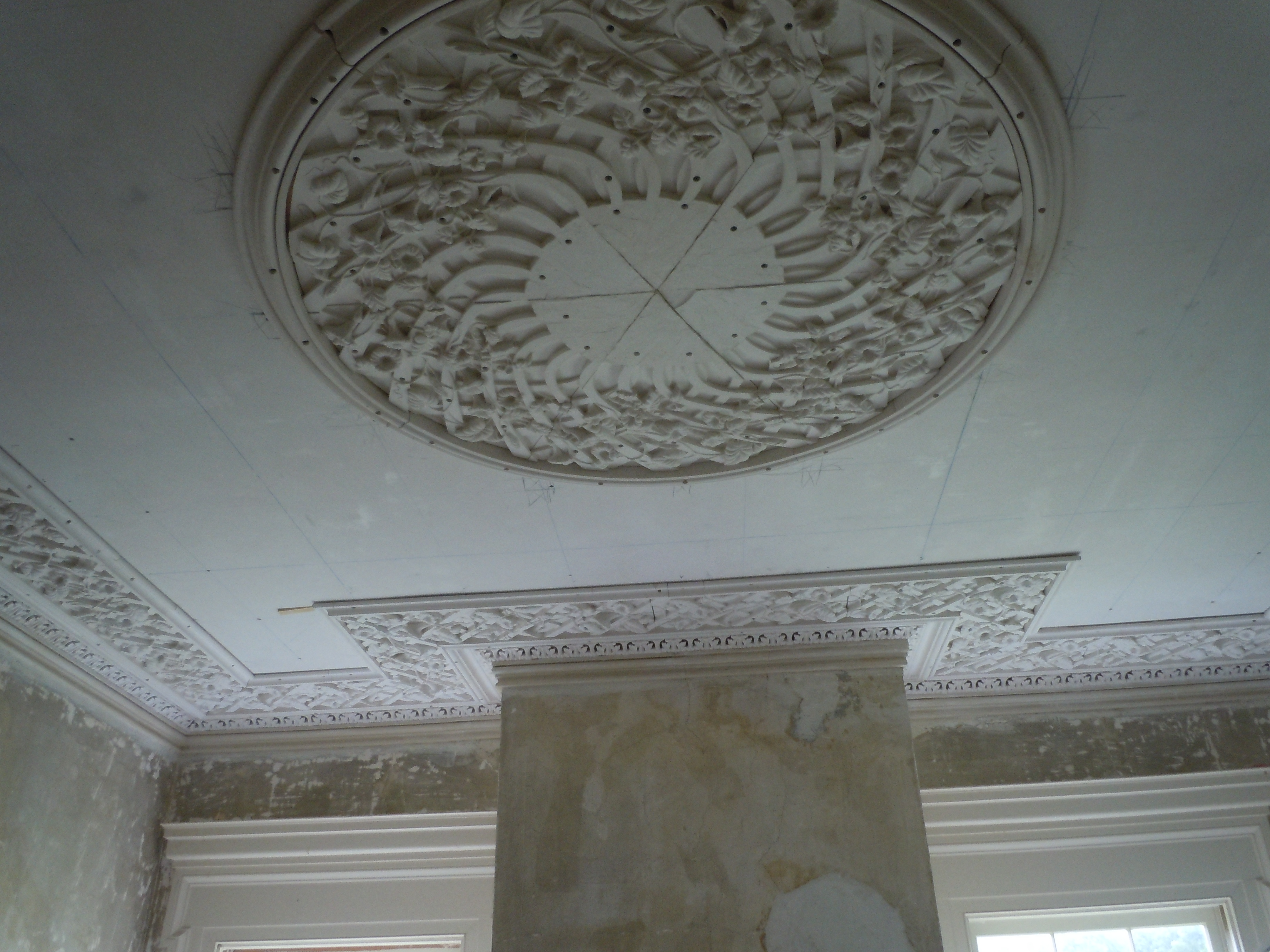 Lattice perimeter and partially installed center medallion in the front room.